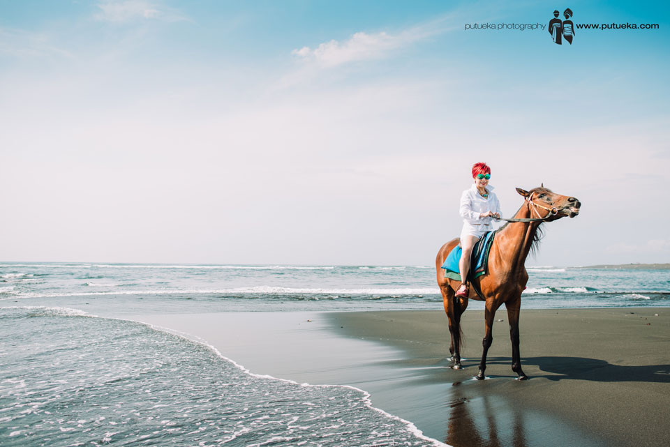 Bali vacation photography with Annie riding horse on the beach