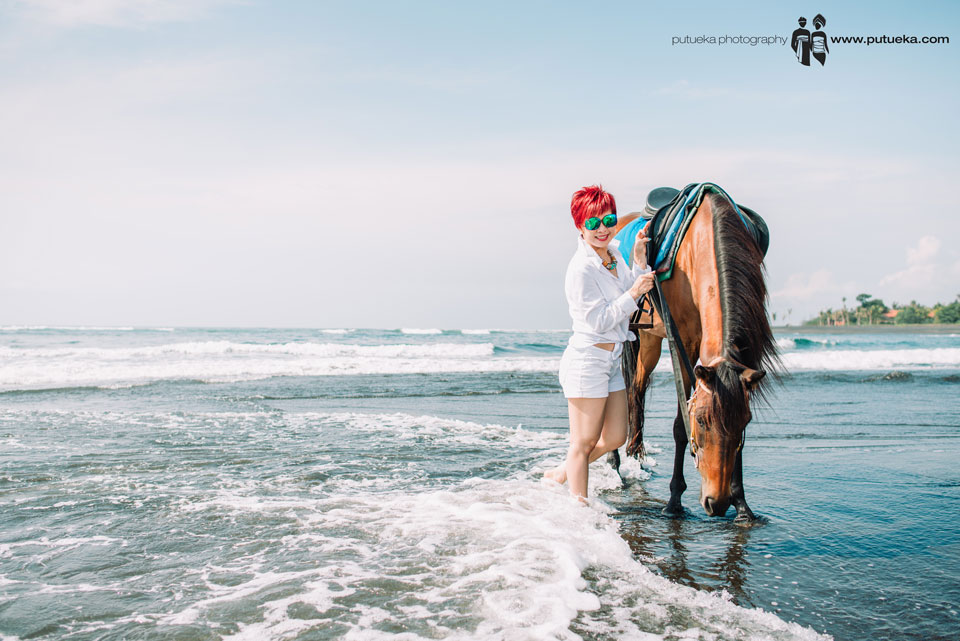 Once in a lifetime experience walking on the beach with horse