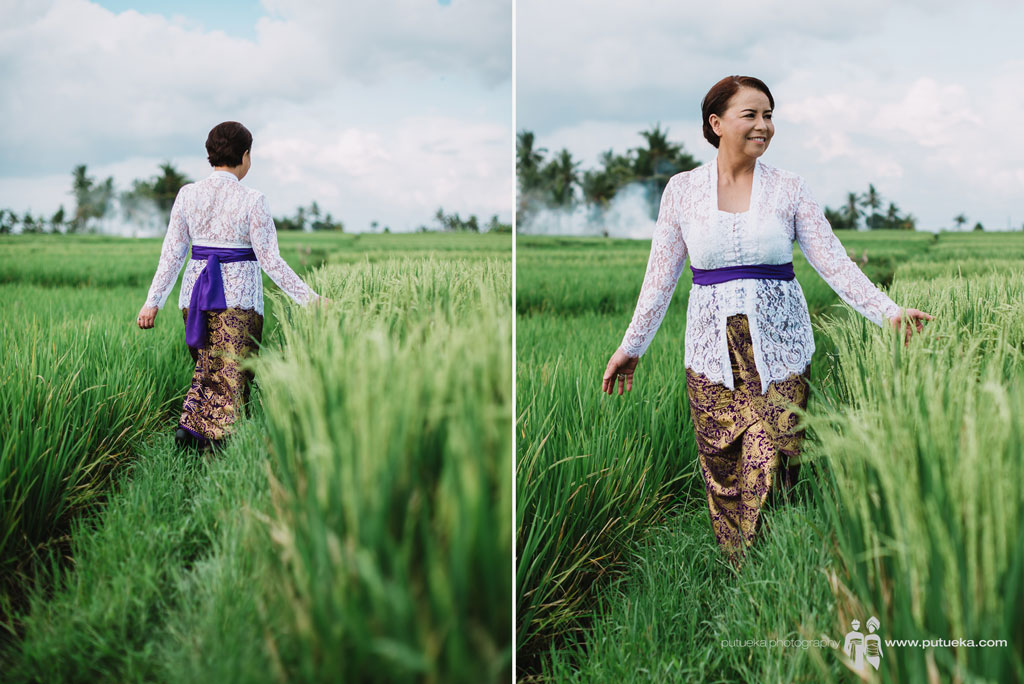 Ms Lina walking through the Tanah Lot rice fields
