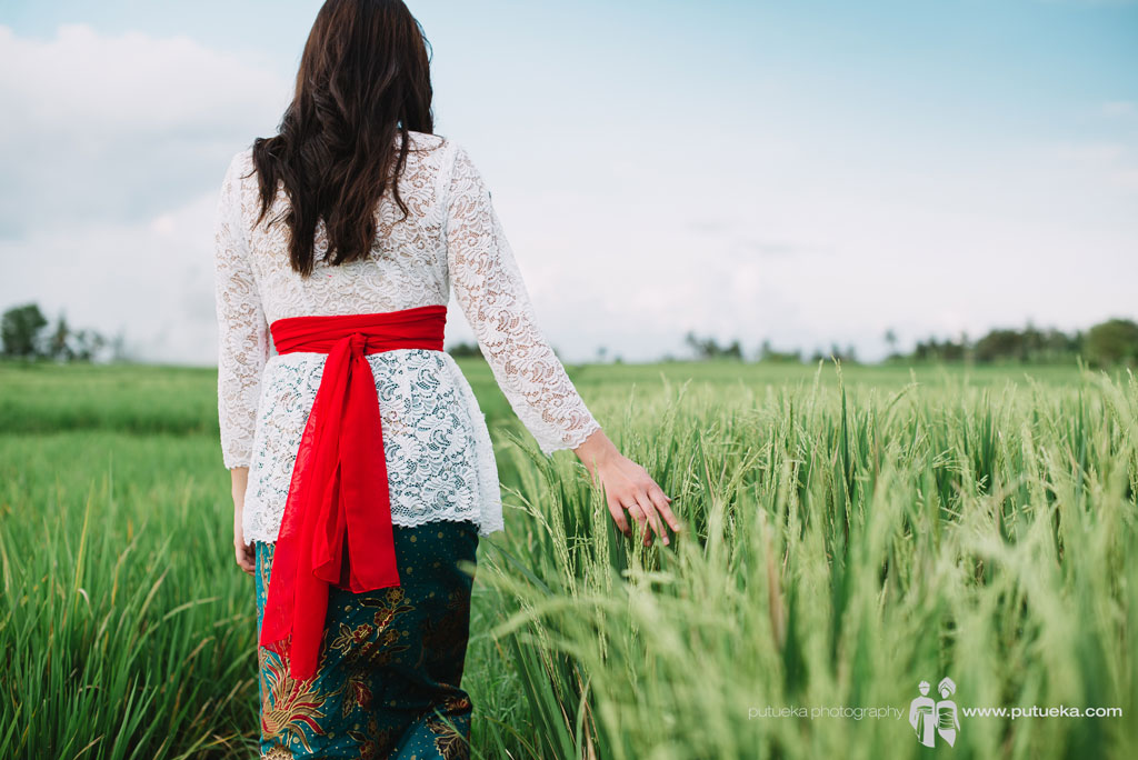 Ms Lina daughter walking through rice fields