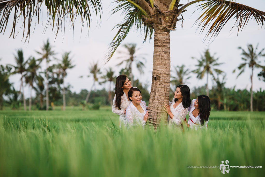 Photo session under coconut tree inside rice fields area