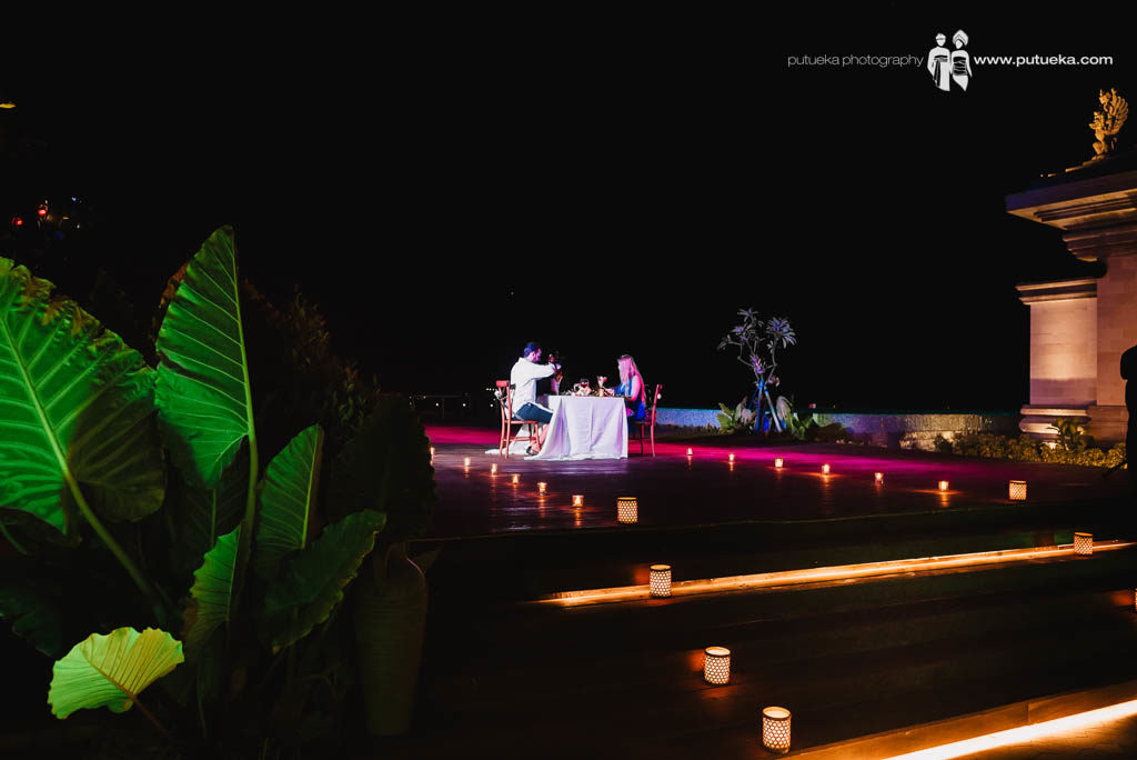 Candle light dinner on honeymoon in bali at hotel roof top bay view