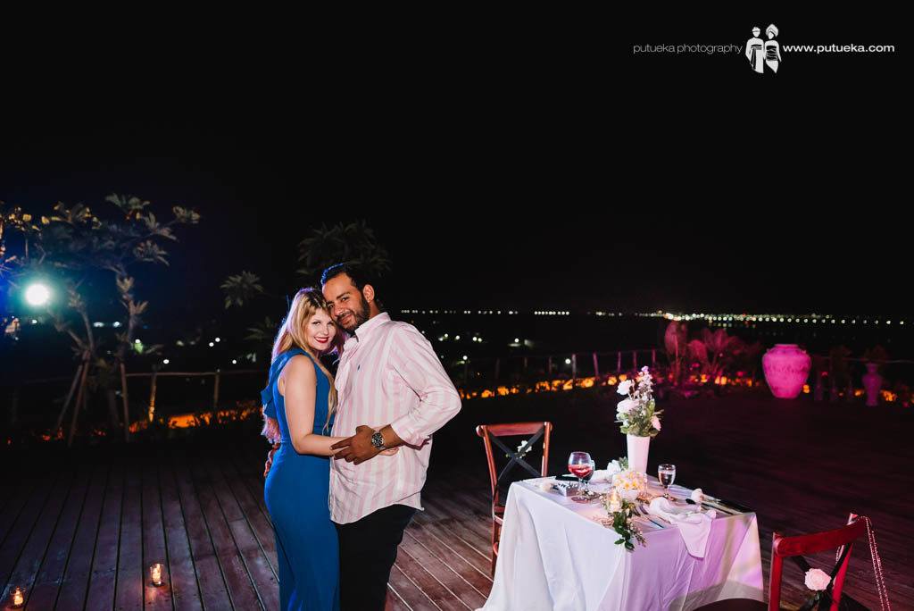 Romantic dance during dinner at hotel roof top